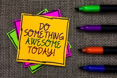 Text sign showing Do Something Awesome Today. Conceptual photo Make an incredible action motivate yourself Written on some colorfu. L sticky note 4 pens laid in royalty free stock photos