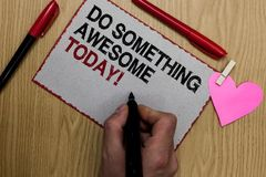 Text sign showing Do Something Awesome Today. Conceptual photo Make an incredible action motivate yourself Written sticky note cli. P pinch heart hand hold Stock Photo