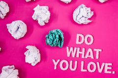 Text sign showing Do What You Love.. Conceptual photo Positive Desire Happiness Interest Pleasure Happy Choice Text Words pink bac. Kground crumbled paper notes royalty free stock photos