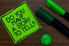 Text sign showing Do You Have A Story To Tell question. Conceptual photo Storytelling Memories Tales Experiences Written on sticky. Note two markers laid on royalty free stock image