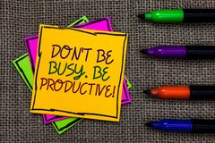 Text sign showing Don t not Be Busy. Be Productive. Conceptual photo Work efficiently Organize your schedule time Written on some. Colorful sticky note 4 pens stock photo