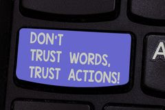 Text sign showing Don T Trust Words Trust Actions. Conceptual photo Less talking more things done action taken Keyboard. Key Intention to create computer royalty free stock photo