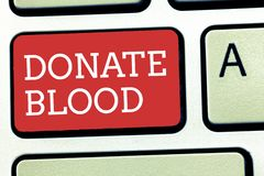 Text sign showing Donate Blood. Conceptual photo Refers to the collection of blood commonly from donors stock image