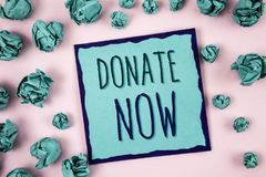 Text sign showing Donate Now. Conceptual photo Give something to charity Be an organ donor Help others. Concept For Information. Text sign showing Donate Now stock photography