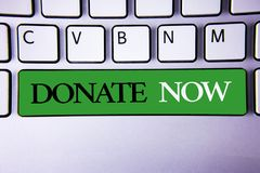 Text sign showing Donate Now. Conceptual photo Give something to charity Be an organ donor Help others. Concept For Information. Text sign showing Donate Now stock photos