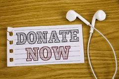 Text sign showing Donate Now. Conceptual photo Give something to charity Be an organ donor Help others. Concept For Information. Text sign showing Donate Now stock image