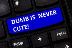 Text sign showing Dumb Is Never Cute. Conceptual photo To be stupid ignorant is never an attractive feature Keyboard key. Intention to create computer message stock photography