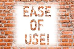 Text sign showing Ease Of Use. Conceptual photo User friendly easy to operate simple technology for everybody Brick Wall. Art like Graffiti motivational call royalty free stock photo