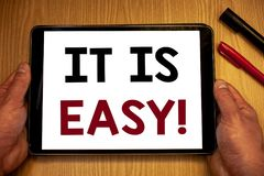 Text sign showing It Is Easy Motivational Call. Conceptual photos Clear Simple Not complicated Basic EffortlessMan hold holding ta. Text sign showing It Is Easy royalty free stock photos