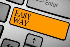 Text sign showing Easy Way. Conceptual photo making hard decision between two less and more effort method Keyboard orange key Inte. Ntion create computer royalty free stock photos