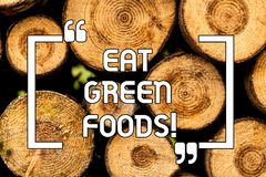 Text sign showing Eat Green Foods. Conceptual photo Eating more vegetables healthy diet vegetarian veggie demonstrating stock photography
