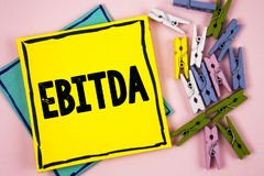 Text sign showing Ebitda. Conceptual photo Earnings before tax is measured to evaluate company performance written on Sticky Note. Text sign showing Ebitda Royalty Free Stock Image