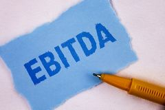 Text sign showing Ebitda. Conceptual photo Earnings before tax is measured to evaluate company performance written on Tear Blue St. Text sign showing Ebitda Royalty Free Stock Images