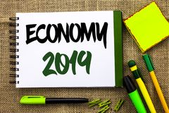 Text sign showing Economy 2019. Conceptual photo Financial Currency Growth Market Earnings Trade Money written on Notebook Book on. Text sign showing Economy Royalty Free Stock Photography