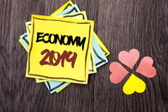Text sign showing Economy 2019. Conceptual photo Financial Currency Growth Market Earnings Trade Money written on Stacked Sticky N. Text sign showing Economy Stock Photos