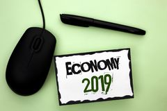 Text sign showing Economy 2019. Conceptual photo Financial Currency Growth Market Earnings Trade Money written on Sticky Note Pape. Text sign showing Economy Stock Photography