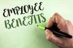 Text sign showing Employee Benefits. Conceptual photo list of advantage recruiter get at work Insurance written by Man holding Mar. Ker in Hand plain background Stock Photo