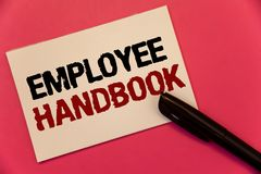 Text sign showing Employee Handbook. Conceptual photo Document Manual Regulations Rules Guidebook Policy Code Text two Words notes. Written note paper black pen stock photo