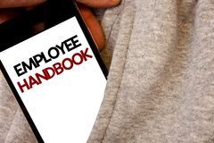 Text sign showing Employee Handbook. Conceptual photo Document Manual Regulations Rules Guidebook Policy Code Words written black. Phone white Screen Hand stock photos