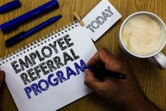 Text sign showing Employee Referral Program. Conceptual photo employees recommend qualified friends relatives Man holding marker n. Otebook clothespin reminder Royalty Free Stock Image