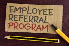 Text sign showing Employee Referral Program. Conceptual photo strategy work encourage employers through prizes written on Cardboar. Text sign showing Employee stock photography