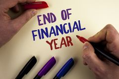 Text sign showing End Of Financial Year. Conceptual photo Taxes time accounting June database cost Sheets written by Man on plain. Text sign showing End Of royalty free stock photos