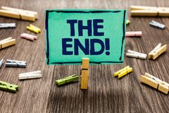Text sign showing The End Motivational Call. Conceptual photo Conclusion of time for something ending of life Random clips art wor. K board creative nice royalty free stock image