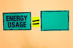 Text sign showing Energy Usage. Conceptual photo Amount of energy consumed or used in a process or system Turquoise paper notes re. Minders equal sign important royalty free stock images