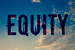 Text sign showing Equity. Conceptual photo Value of a company divided into equal parts owned by shareholders Ideas messages blue c. Louds cloudy sky splatters royalty free stock photo