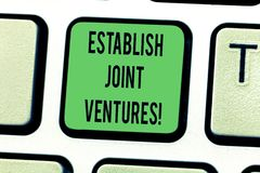Text sign showing Establish Joint Ventures. Conceptual photo Two or more companies invest in a certain business Keyboard key. Intention to create computer royalty free stock images