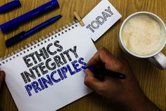 Text sign showing Ethics Integrity Principles. Conceptual photo quality of being honest and having strong moral Man holding marker. Notebook clothespin reminder royalty free stock images
