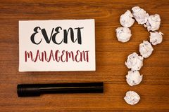 Text sign showing Event Management. Conceptual photo Special Occasion Schedule Organization Arrange Activities Ideas on paper wood. En background quotation mark stock images