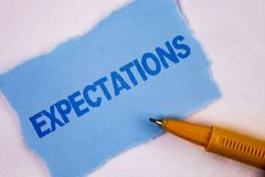 Text sign showing Expectations. Conceptual photo Huge sales in equity market assumptions by an expert analyst written on Tear Blue. Text sign showing royalty free stock photo