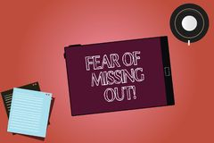 Text sign showing Fear Of Missing Out. Conceptual photo Afraid of losing something or someone stressed Tablet Empty. Screen Cup Saucer and Filler Sheets on stock illustration