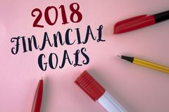 Text sign showing 2018 Financial Goals. Conceptual photo New business strategy earn more profits less investment written on plain. Text sign showing 2018 Stock Photography
