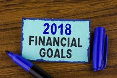 Text sign showing 2018 Financial Goals. Conceptual photo New business strategy earn more profits less investment written on Sticky. Text sign showing 2018 Stock Images