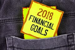 Text sign showing 2018 Financial Goals. Conceptual photo New business strategy earn more profits less investment written on Yellow. Text sign showing 2018 Stock Photo