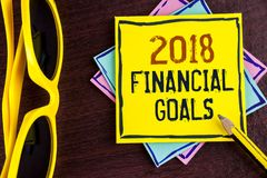 Text sign showing 2018 Financial Goals. Conceptual photo New business strategy earn more profits less investment written on Yellow. Text sign showing 2018 Stock Image