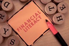 Text sign showing Financial Literacy. Conceptual photo Understand and knowledgeable on how money works.  stock photo