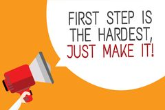 Text sign showing First Step Is The Hardest, Just Make It. Conceptual photo dont give up on final route Man holding megaphone loud. Speaker speech bubble message Stock Images