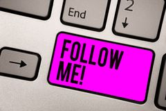 Text sign showing Follow Me. Conceptual photo Inviting a person or group to obey your prefered leadership Keyboard purple key Inte. Ntion create computer royalty free stock image