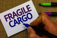 Text sign showing Fragile Cargo. Conceptual photo Breakable Handle with Care Bubble Wrap Glass Hazardous Goods Man hand. Holding marker white paper royalty free stock image
