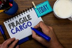 Text sign showing Fragile Cargo. Conceptual photo Breakable Handle with Care Bubble Wrap Glass Hazardous Goods Man holding marker. Notebook clothespin reminder stock photography