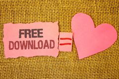 Text sign showing Free Download. Conceptual photo Files Downloading Without Any Charges Online Technology Text pink torn note equa. Ls is pink heart love message royalty free stock images