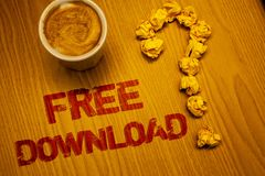 Text sign showing Free Download. Conceptual photo Files Downloading Without Any Charges Online Technology Words written Desk Coffe. E White mug crumbled paper stock photo
