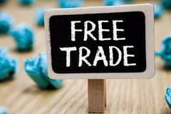 Text sign showing Free Trade. Conceptual photo The ability to buy and sell on your own terms and means Blackboard crumpled papers. Several tries mistake not stock image