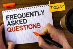 Text sign showing Frequently Asked Questions. Conceptual photo most common inquiries Informations Help Guide written by Man on Not. Text sign showing Frequently Stock Photo