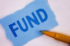 Text sign showing Fund. Conceptual photo Large amount of money is released from bank for particular purpose written on Tear Blue S. Text sign showing Fund Stock Photo
