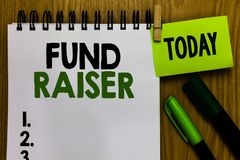 Text sign showing Fund Raiser. Conceptual photo person whose job or task is seek financial support for charity Notebook clothespin royalty free stock photo