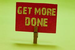 Text sign showing Get More Done. Conceptual photo Checklist Organized Time Management Start Hardwork Act Clothespin holding red pa. Per important communicating stock images